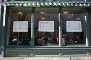 History Scene 1914 - panels on side window of Claire's Corner Copia